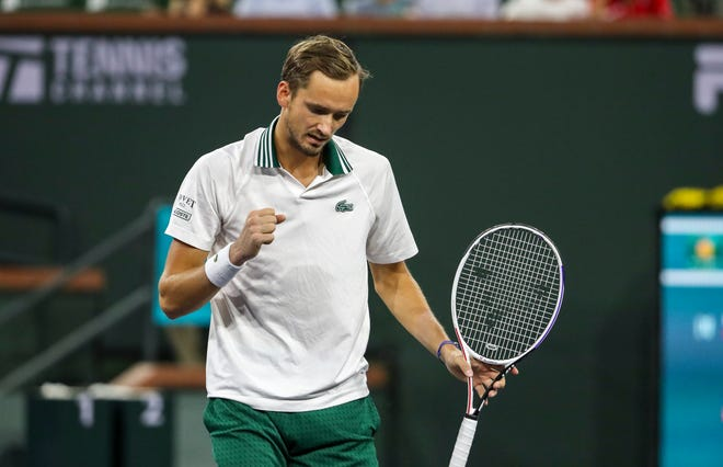 Daniil Medvedev of Russia celebrates winning a game against Mackenzie McDonald of the United States in the first set of their round two match of the BNP Paribas Open at the Indian Wells Tennis Garden, Saturday, Oct. 9, 2021, in Indian Wells, Calif.