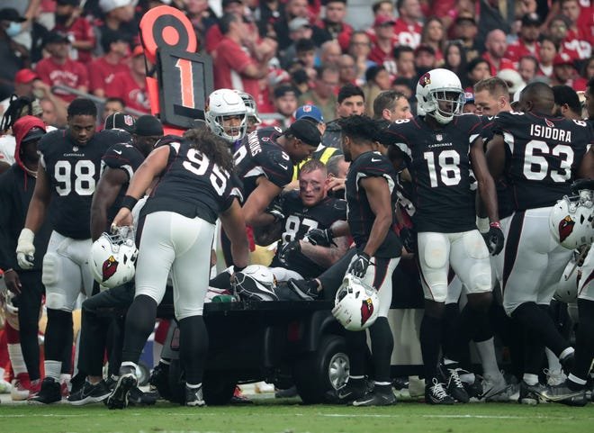 Oct 10, 2021; Glendale, Arizona, USA; Arizona Cardinals tight end Maxx Williams (87) is greeted by teammates while taken off the field after an injury against the San Francisco 49ers during the second quarter at State Farm Stadium.