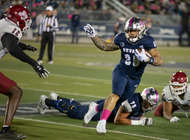 Nevada running back Toa Taua (35) runs against New Mexico State in the first half Saturday,