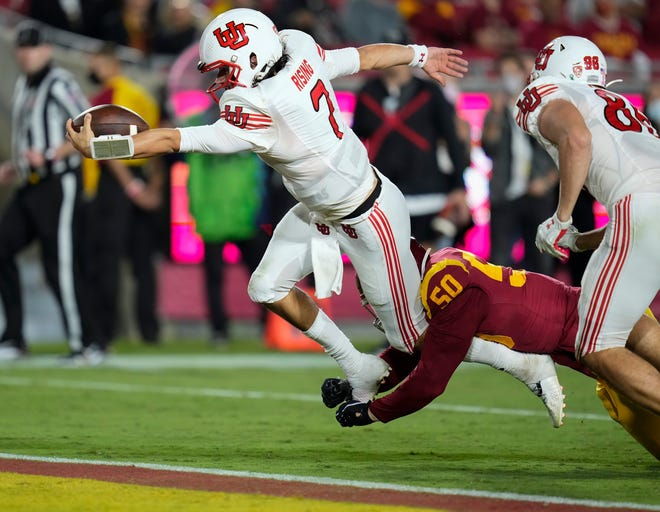 Newbury Park High graduate Cameron Rising dives into the end zone to score a third-quarter touchdown during Utah's 42-26 victory over USC on Saturday, Oct. 9, 2021, at the Coliseum.