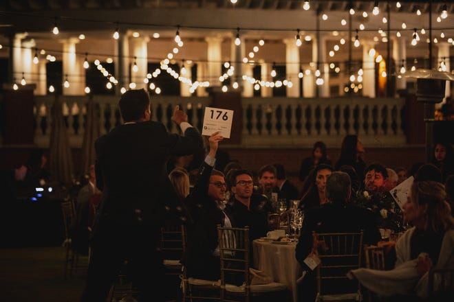 Guests of Interface's Hope & Light benefit Sept. 18 bid on auction  items. Proceeds from the event helped the Camarillo nonprofit provide its social services.
