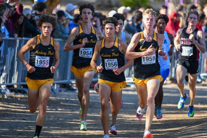 Newbury Park's Lex Young (left to right), Colin Sahlman, Leo Young, and Aaron Sahlman lead at the mile mark of the championship race of the Clovis Invitational on Saturday.