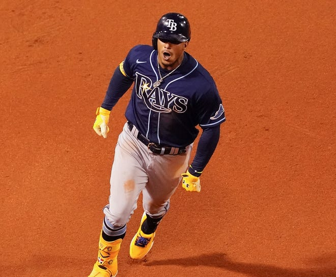 Tampa Bay Rays shortstop Wander Franco (5) reacts as he runs the bases after hitting a solo home run against the Boston Red Sox during the eighth inning.