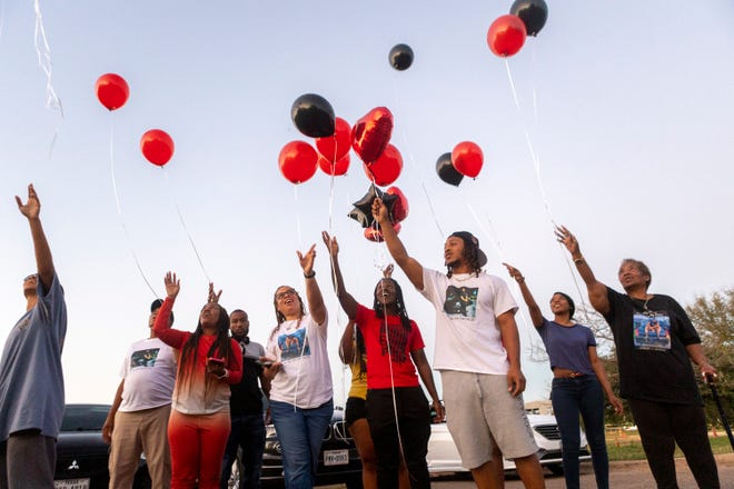 Family and friend release balloons during a ceremony to remember the life of Cornelia Moore at Zilker Park Oct., 4. Moore was shot and killed during a road rage incident in North Austin early in September. Her death was the city's 57th homicide case of the year.