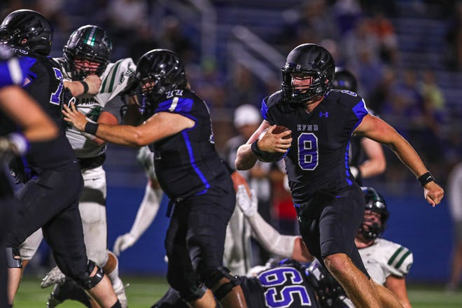 Georgetown quarterback Darson Herman, right, runs the ball against Cedar Park earlier this season. On Friday, Herman accounted for 284 yards and six combined touchdowns in Georgetown's 56-9 victory over Hendrickson, which gave the Eagles their first district win.