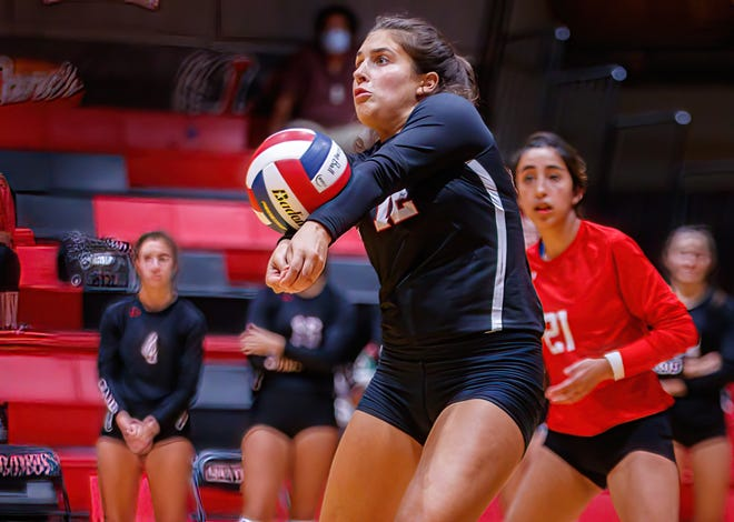 Lake Travis outside hitter Arden Besecker, passing the ball in a nondistrict win over San Antonio Churchill earlier this season, ripped 23 kills and had 22 digs to help the Cavs pull into a first-place tie with a win over Austin High Friday.