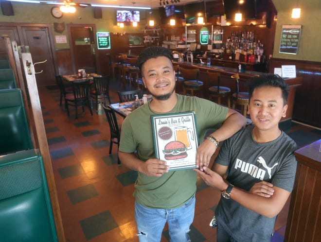 Louie's Bar & Grille co-owners Raj Gurung, left, and Chakra Gurung at the newly remodeled restaurant.