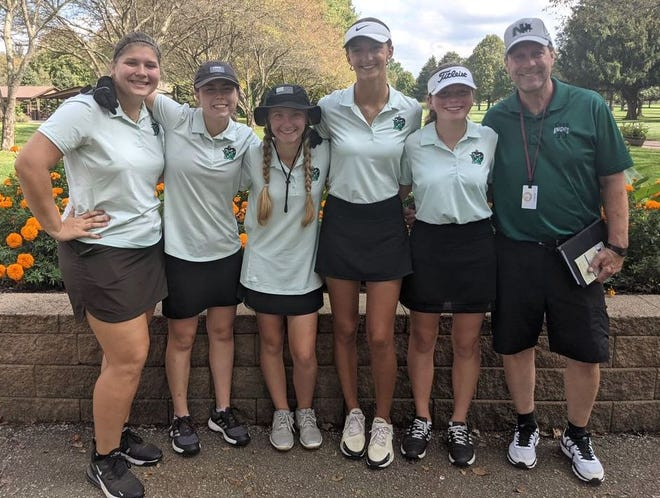 The Nordonia girls golf team is all smiles after qualifying for the district tournament for the second straight year. The Knights finished second at the Division I sectional tournament at Fox Den Golf Course in Stow Oct. 6, shooting a school record score of 316.