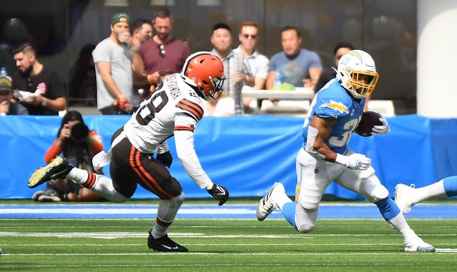 Chargers running back Austin Ekeler runs the ball against Browns outside linebacker Jeremiah Owusu-Koramoah in the first half, Oct. 10, 2021, Inglewood, Calif. (Richard Mackson-USA TODAY Sports)