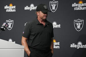 Las Vegas Raiders head coach Jon Gruden leaves after speaking during a news conference after an NFL football game against the Chicago Bears, Sunday, Oct. 10, 2021, in Las Vegas.