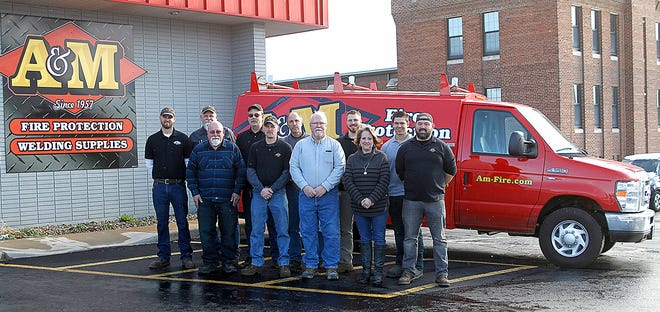 A&M Fire Protection and Welding Supplies employees, from left, front row, Bill Sidle, Kurt Karper, John Sidle, Stacie Sidle, Jasen Cherry; back row, Mark Fitch, Mike Greshner, Tim Kershner, Paul Spicer, Zack Sidle and Bryce Wood stand in front of a company van outside the East Main Street business celebrating 60 years in business. Friday, March 10, 2017. Not pictured were employees Missy Freelon and Wyatt Music.
