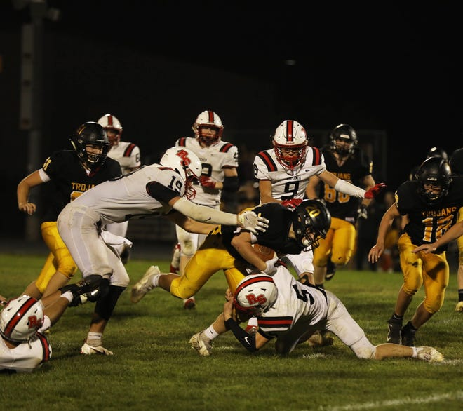 Roland-Story linebacker Hesston Johnson brings down West Marshall ball carrier Ben Gonzalez as Luke Patton (19) and Kale Lande (9) come in for support during the Norsemen's 50-21 loss to the No. 2 Trojans Friday at State Center.