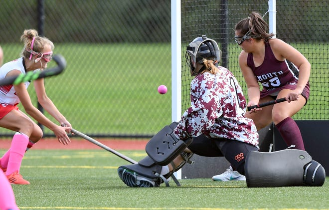HYANNIS  10/11/21  Reagan Hicks of Barnstable fires a shot past Falmouth goalie Kyleigh Waggett and Drea Perez.  field hockey