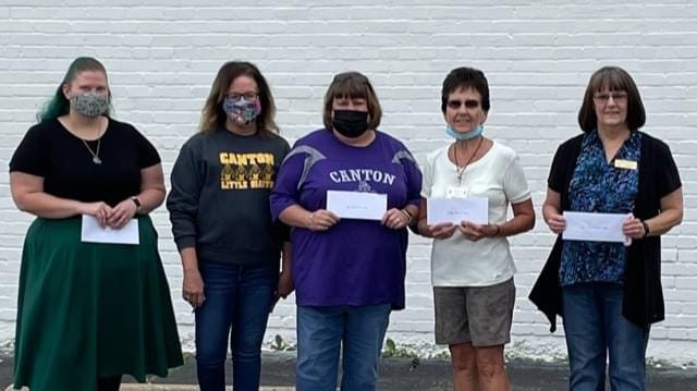 The Canton Helping Hands Resale Shoppe recently distributed $8,635 for the month of September among the following groups (representatives are pictured from the left): Tiffany Kaufmann, Girl Scouts; Wendy Mayall, Store Manager; Heidi Marriott, Big Brother/Big Sisters and Mary Lou Inskeep, a volunteer representing the Valley School District.