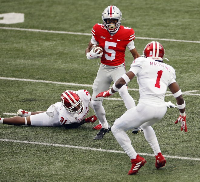 Ohio State Buckeyes wide receiver Garrett Wilson (5) gets past Indiana Hoosiers defensive back Bryant Fitzgerald (31) after a catch during the first quarter in their NCAA Division I football game on Saturday, Nov. 21, 2020 at Ohio Stadium in Columbus, Ohio.