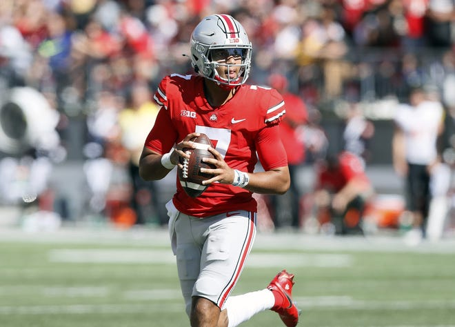 Ohio State Buckeyes quarterback C.J. Stroud (7) looks the throw the ball against Maryland Terrapins during the second quarter of their NCAA college football game at Ohio Stadium in Columbus, Ohio on October 9, 2021.
