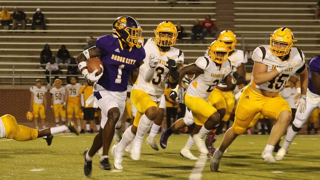 Dodge City CC football player, Cameron Faison rushes to the right for the Conquistadors as they battled Garden City in homecoming game.