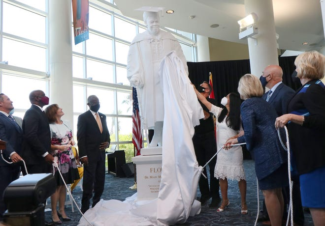 Master sculptor Nilda Comas and members of the Dr. Mary McLeod Bethune Statuary Fund pull the ropes to unveil the statue of Dr. Mary McLeod Bethune, in Daytona Beach, Monday October 11, 2021 at the news Journal Center.