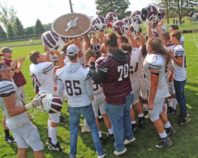 The Union City Chargers celebrate with their fight song and the Shield after gutting out a big win over Bronson on Saturday