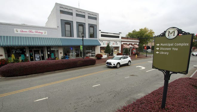 An SUV heads through Main Street in Mount Holly Monday morning. In November, city residents will get to vote on a bond referendum to fund recreation.