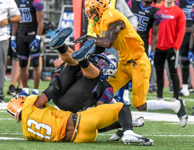 Garden City Community College defenders Jacob Hollins (13) and Raymond Cutts combine to drop Hutchinson quarterback Dylan Liable for a loss Oct. 2 at Broncbuster Stadium.  GCCC's defense captured a shutout on Saturday at Dodge City, 49-0.