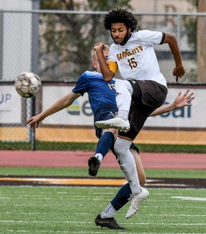 Garden City Community College's Leslie Green moves a loose ball to a teammate Saturday against Randall University in soccer action at broncbuster Stadium. GCCC dropped the match 0-2.