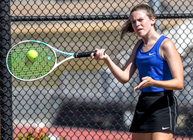 Garden City High School's Sage Riggs hits a forehand shot during a double match in September in the GCHS girls tennis invite.  Riggs, and partner Sydney Nanninga, won the doubles competition in a Class 6A regional tournament Saturday at Dodge City.