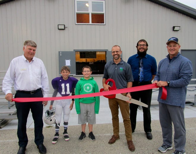 A ribbon cutting was held on Oct. 5 to officially open the Geneseo Park District's new building at the Park District's Athletic Field on East North St. In the photo at the ceremony are, from left, Brett Lohman, representing the Geneseo Foundation; Gibson Minard, ready for youth football; James Winkleman, guest at the ribbon cutting; Andy Thurman, executive director at the Geneseo Park District; Zack Sullivan, executive director of the Geneseo Chamber of Commerce; and Brad Toone, Geneseo Youth Football board member.