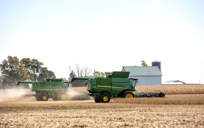 An Illinois farmer harvests crops in the field. Both corn and soybeans could be used to produce sustainable aviation fuel in the future