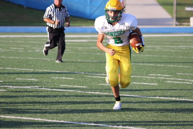Freshman Zachary Montez carries the ball at the Geneseo vs. Quincy freshman-sophomore game on Friday, Oct. 8. Both freshman-sophomore and varsity teams suffered losses at Quincy