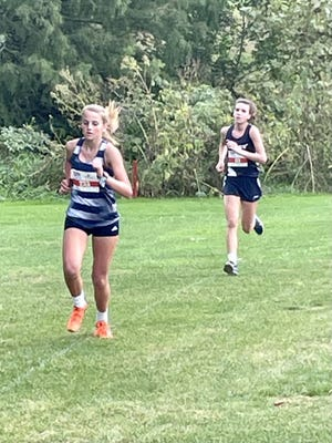 Miranda Reed battles for second place at the LTC Cross Country Meet on Thursday, October 7th at Midland Golf Course.
