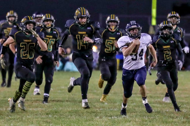 Knoxville's Seth Clay outruns the Tornados for a long gain during a game on Friday, Sept. 28, 2018 at  Don Viar Memorial Field in Abingdon.