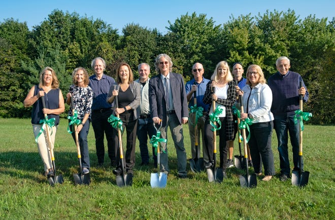 The Monroe County Public Library broke ground Saturday on the forthcoming Southwest Branch Library, 890 W. Gordon Pike. Pictured are the library board of trustees and administrators, from left, Katherine E. Loser, Jaime Burkhart, Grier Carson, Marilyn Wood, Josh Wolf, John A. Walsh, Tom Bunger, Kari Esarey, David L. Ferguson, Christine Harrison and Fred Risinger. For more information, visit mcpl.info/branchplan.