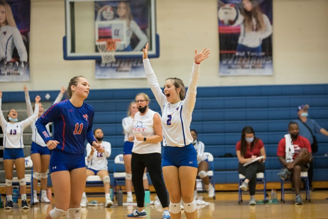 West Henderson's Ann Herring  (2) celebrates a point for the Falcons in their game against T.C. Roberson earlier this season at West.