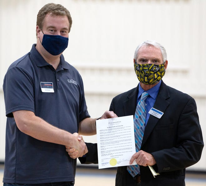Kirksville Mayor Zac Burden, left, poses with Dan Martin during a ceremony at the Thompson Campus Center on Friday, Oct. 8, 2021. Burden issued a proclamation declaring that day as Dan Martin Health and Fitness Day in Kirksville.