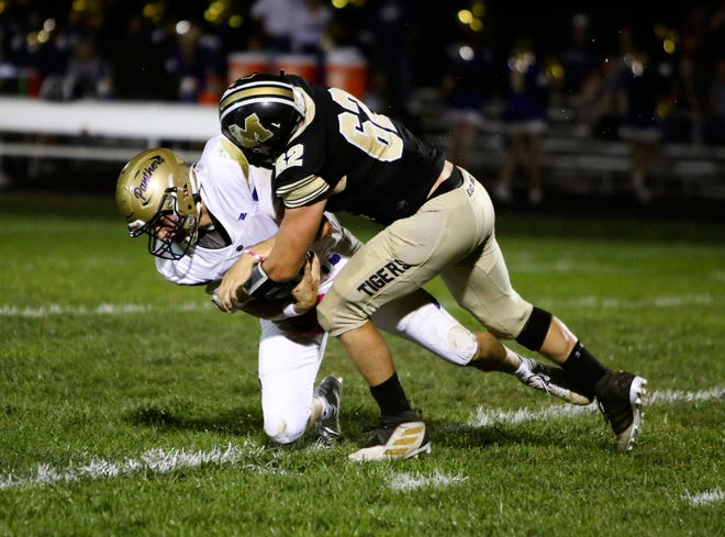 Senior linebacker Hunter Quinn of the 2021 Marceline High School football Tigers makes a 1-on-1 tackle of a Salisbury Panther during last Friday's 49-24 MHS home win. Quinn was credited with seven total tackles, four unassisted like this one, with two for lost SHS yardage.