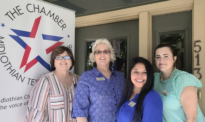 Members of the staff of the Midlothian Chamber of Commerce pose with Chamber president and CEO Laura Terhune (second from left).