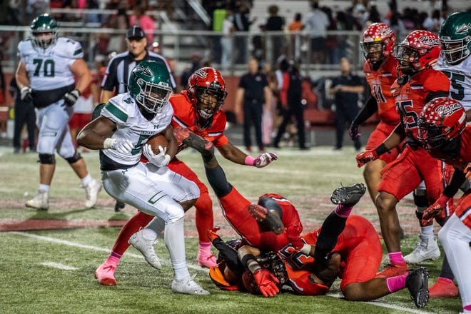 Waxahachie running back Jayden Becks finds the way blocked during Friday night's District 11-6A game at Cedar Hill. The Longhorns scored late to edge the Indians, 14-10.