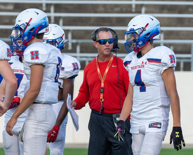 Heritage head coach Lee Wiginton gives instructions to junior wide receiver Rylan Figueroa (4) during a preseason scrimmage. The Jaguars rolled past Brownwood on Friday night, 43-25.