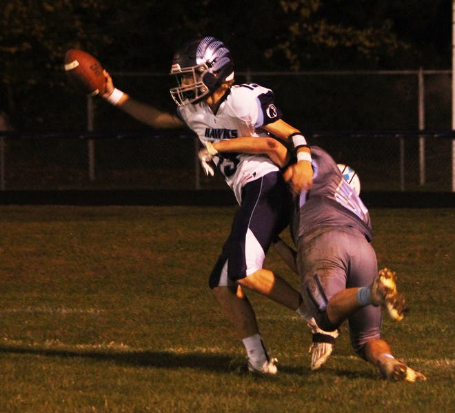 Travis Trachsel holds the ball high after making a catch in the end zone for a touchdown against Olympia.