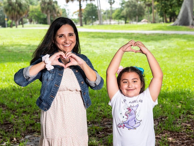 Isandra, Program Exploration and Implementation Lead at Children's Services Council of Palm Beach County, and her daughter.