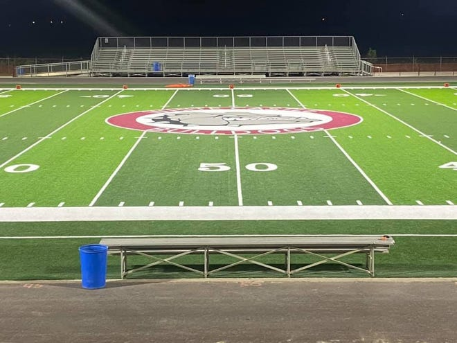 An artificial turf and new lighting adorn the refurbished Rocky Ourso Memorial Bulldog Stadium at White Castle High School during the first game after upgrades to the facility.
