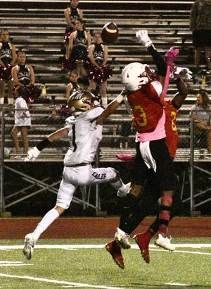 St. John's Michael Edwards (1) blocks a pass to East Iberville running back Travis Brooks in the District 7-1A opener for both teams.