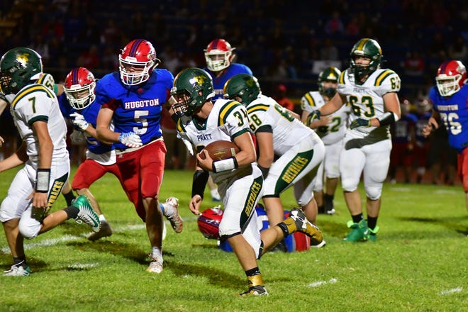 Pratt High School's Jack Barker (#34) tucks the football in for a scamper cross-field in the Friday match-up between league giants. Pratt won the game 44-7 and improved to 5-1 overall.