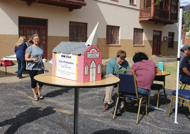 Free will donations totaled more than $1,200 on Saturday afternoon made during the annual Front Porch BBQ Festival in Pratt. JAG-K students from Pratt helped set up and tear down tables and chairs for the event.