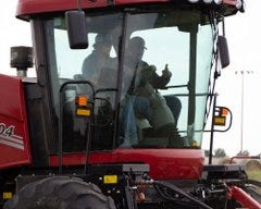 Manager Rodney Walker recently brought a new swather to the PCC campus, allowing Ag Power students an in-depth look at modern machinery, and a good test drive.