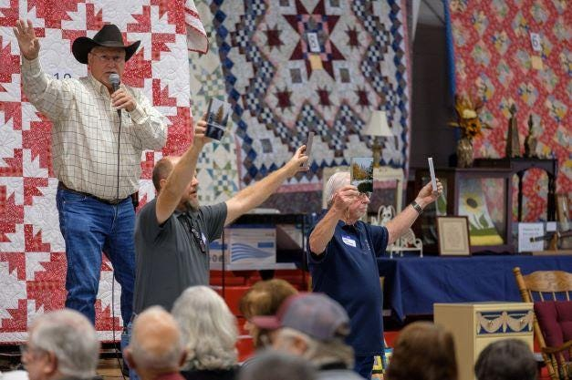 John Hamm was the auctioneer at the recent Ladies Auxiliary Auction, a 90th Anniversary event which raised more than $129,000 for Barclay College student scholarships. That amount is more than ever raised before at such an event.