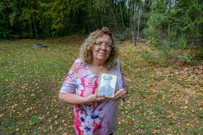 Lois A. Marandola holds a picture of her uncle, Army 1st Lt. Anthony R. Mazzulla, in her Johnston backyard. The remains of Mazzulla, who was killed in the Korean War, are scheduled to be returned to Rhode Island on Tuesday.