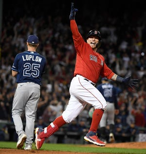 The Red Sox's Christian Vazquez runs around the bases after hitting a two-run, walk-off home run against the Tampa Bay Rays in the 13th inning of Game 3 in the ALDS, giving Boston a 2-1 series lead on Sunday night.