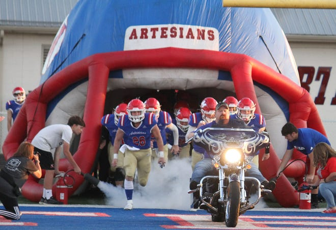 Martinsville makes grand entrance before Friday's Mid-State Conference game and senior night against Mooresville.